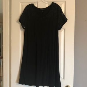 Black swing dress with lace sleeves and bodice